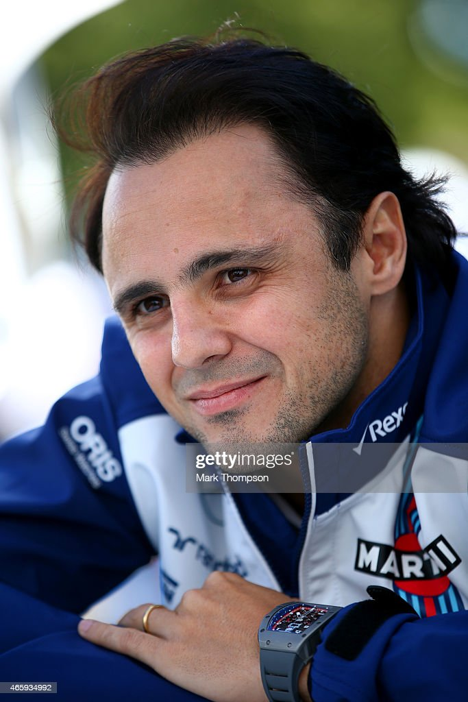 Felipe Massa of Brazil and Williams speaks with members of the media in the paddock during previews to the Australian Formula One Grand Prix at Albert Park on March 12, 2015 in Melbourne, Australia.
