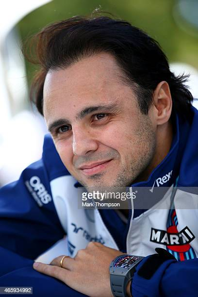 Felipe Massa of Brazil and Williams speaks with members of the media in the paddock during previews to the Australian Formula One Grand Prix at...