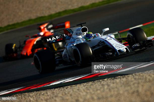 Felipe Massa of Brazil drives the Williams Martini Racing Williams FW40 Mercedes ahead of Stoffel Vandoorne of Belgium in the McLaren Honda Formula 1...