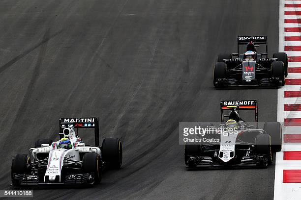 Felipe Massa of Brazil driving the Williams Martini Racing Williams FW38 Mercedes PU106C Hybrid turbo battles for position with Sergio Perez of...
