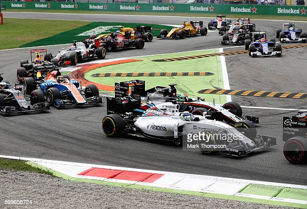 Felipe Massa of Brazil driving the Williams Martini Racing Williams FW38 Mercedes PU106C Hybrid turbo and Nico Hulkenberg of Germany driving the...