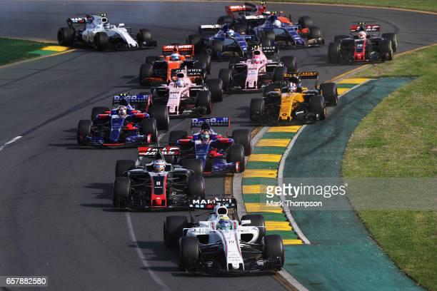 Felipe Massa of Brazil driving the Williams Martini Racing Williams FW40 Mercedes leads Romain Grosjean of France driving the Haas F1 Team...