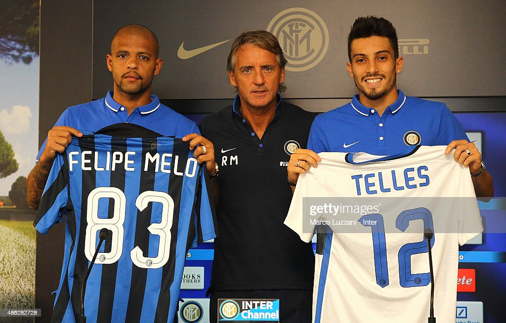 <a gi-track='captionPersonalityLinkClicked' href=/galleries/search?phrase=Felipe+Melo&family=editorial&specificpeople=646942 ng-click='$event.stopPropagation()'>Felipe Melo</a> (L) and <a gi-track='captionPersonalityLinkClicked' href=/galleries/search?phrase=Alex+Telles&family=editorial&specificpeople=10074392 ng-click='$event.stopPropagation()'>Alex Telles</a> (R), new signings for FC Internazionale Milano pose with the club shirt with FC Internazionale Milano coach <a gi-track='captionPersonalityLinkClicked' href=/galleries/search?phrase=Roberto+Mancini&family=editorial&specificpeople=234429 ng-click='$event.stopPropagation()'>Roberto Mancini</a> (C) during a press conference at the club's training ground on September 3, 2015 in Appiano Gentile Como, Italy.