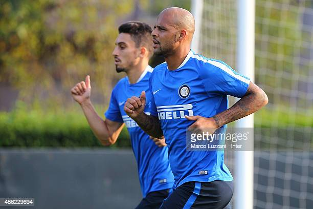 Felipe Melo and Alex Telles of FC Internazionale train during FC Internazionale training session at the club's training ground on September 2 2015 in...