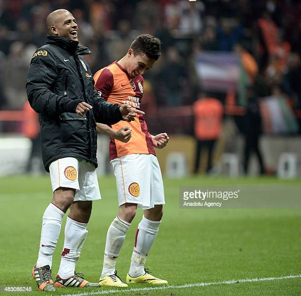 Felipe Melo and Alex Telles of Galatasaray react as the team scores during the Turkish Spor Toto Super League football match between Galatasaray and...