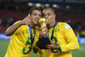 Felipe Melo and Gilberto Silva of Brazil celebrate during the 2009 Confederations Cup final match between Brazil and USA from Ellis Park on June 28...