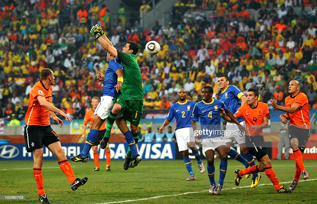 <a gi-track='captionPersonalityLinkClicked' href=/galleries/search?phrase=Felipe+Melo&family=editorial&specificpeople=646942 ng-click='$event.stopPropagation()'>Felipe Melo</a> and Julio Cesar of Brazil jump to defend a cross from Wesley Sneijder of the Netherlands which results in an own goal by Melo during the 2010 FIFA World Cup South Africa Quarter Final match between Netherlands and Brazil at Nelson Mandela Bay Stadium on July 2, 2010 in Nelson Mandela Bay/Port Elizabeth, South Africa.