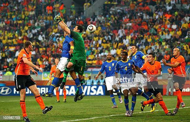 Felipe Melo and Julio Cesar of Brazil jump to defend a cross from Wesley Sneijder of the Netherlands which results in an own goal by Melo during the...