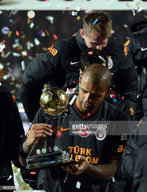 Felipe Melo holds the cup as Turkish team Galatasaray won Turkish Airlines Antalya Cup by defeating Scottish giants Celtic in penalty shootout 54...