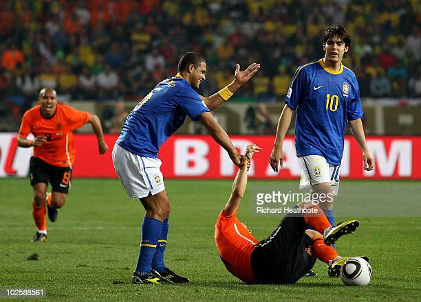 Felipe Melo of Brazil attempts to pull up to his feet the injured Arjen Robben of the Netherlands Melo receives a red card and is sent off for the...