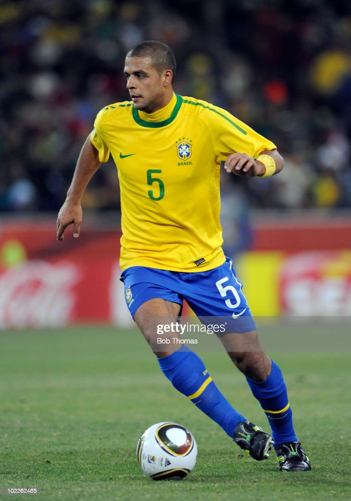 <a gi-track='captionPersonalityLinkClicked' href=/galleries/search?phrase=Felipe+Melo&family=editorial&specificpeople=646942 ng-click='$event.stopPropagation()'>Felipe Melo</a> of Brazil during the 2010 FIFA World Cup South Africa Group G match between Brazil and Ivory Coast at Soccer City Stadium on June 20, 2010 in Johannesburg, South Africa. Brazil won the match 3-1.