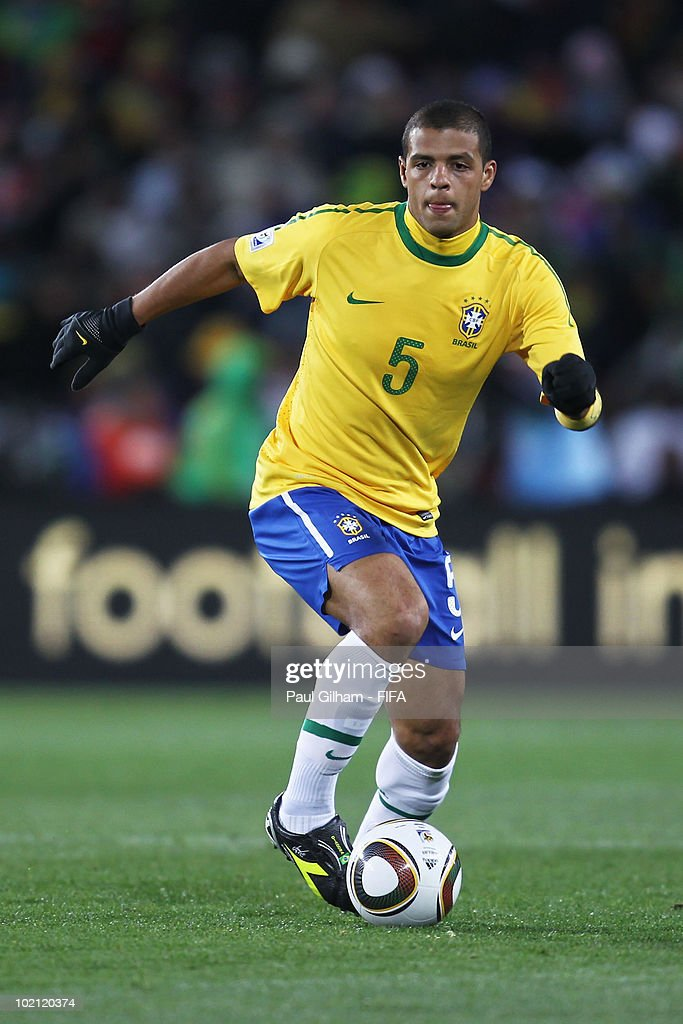<a gi-track='captionPersonalityLinkClicked' href=/galleries/search?phrase=Felipe+Melo&family=editorial&specificpeople=646942 ng-click='$event.stopPropagation()'>Felipe Melo</a> of Brazil runs with the ball during the 2010 FIFA World Cup South Africa Group G match between Brazil and North Korea at Ellis Park Stadium on June 15, 2010 in Johannesburg, South Africa.