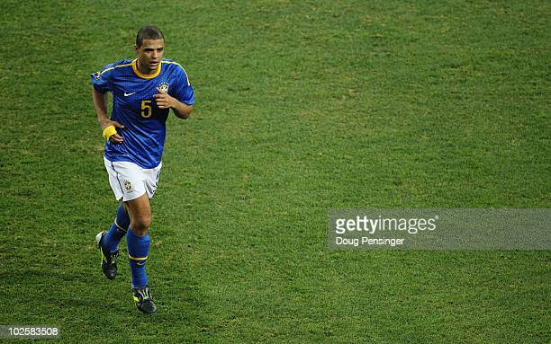 Felipe Melo of Brazil walks off the pitch after being sent off following a tackle on Arjen Robben of the Netherlands during the 2010 FIFA World Cup...