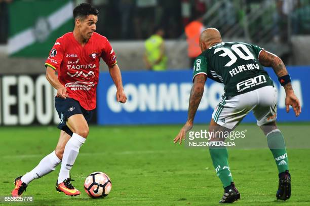 Felipe Melo of Brazil's Palmeiras tries to stop Thomas Santos of Bolivia's Jorge Wilstermann during their Libertadores Cup football match held at...