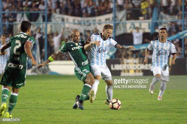 Felipe Melo of Brazil's Palmeiras vies for the ball with Cristian Menendez of Argentina's Atletico Tucuman during their Copa Libertadores football...