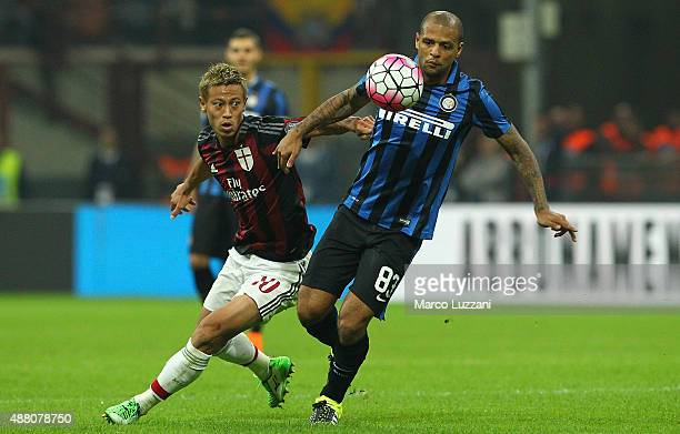Felipe Melo of FC Internazionale Milano competes for the ball with Keisuke Honda of AC Milan during the Serie A match between FC Internazionale...