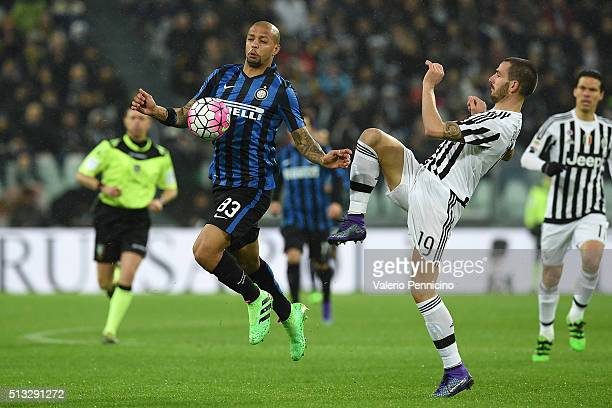 Felipe Melo of FC Internazionale Milano is tackled by Leonardo Bonucci of Juventus FC during the Serie A match between Juventus FC and FC...
