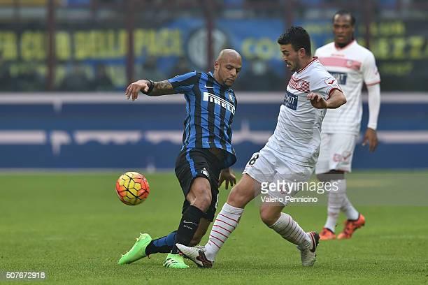 Felipe Melo of FC Internazionale Milano is tackled by Raffaele Bianco of Carpi FC during the Serie A match between FC Internazionale Milano and Carpi...
