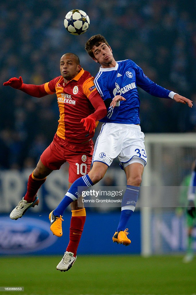 <a gi-track='captionPersonalityLinkClicked' href=/galleries/search?phrase=Felipe+Melo&family=editorial&specificpeople=646942 ng-click='$event.stopPropagation()'>Felipe Melo</a> of Galatasaray and Roman Neustaedter of Schalke go up for a header during the UEFA Champions League round of 16 second leg match between Schalke 04 and Galatasaray AS at Veltins-Arena on March 12, 2013 in Gelsenkirchen, Germany.