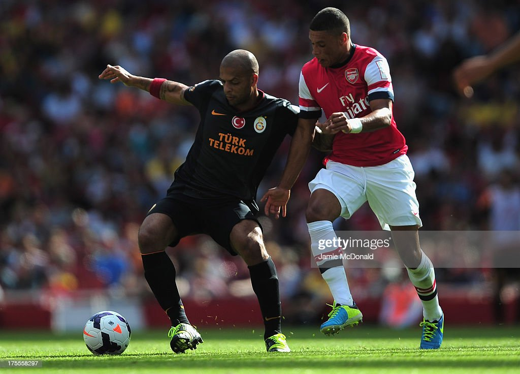 Felipe Melo of Galatasaray battles with Alex Oxlade Chamberlain of Arsenal during the Emirates Cup match between Arsenal and Galatasaray at the Emirates Stadium on August 4, 2013 in London, England.