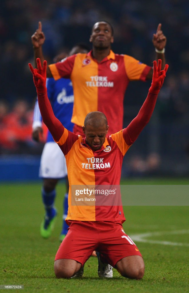 <a gi-track='captionPersonalityLinkClicked' href=/galleries/search?phrase=Felipe+Melo&family=editorial&specificpeople=646942 ng-click='$event.stopPropagation()'>Felipe Melo</a> of Galatasaray celebrates next to <a gi-track='captionPersonalityLinkClicked' href=/galleries/search?phrase=Didier+Drogba&family=editorial&specificpeople=179398 ng-click='$event.stopPropagation()'>Didier Drogba</a> after the UEFA Champions League round of 16 second leg match between FC Schalke 04 and Galatasaray AS at Veltins-Arena on March 12, 2013 in Gelsenkirchen, Germany.