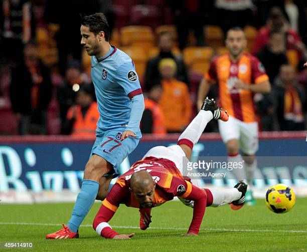 Felipe Melo of Galatasaray in action against Musa Nizam of Trabzonspor during the Turkish Spor Toto Super League soccer match between Galatasaray and...