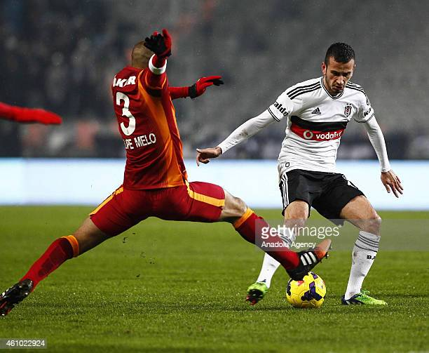 Felipe Melo of Galatasaray is in action against Oguzhan Ozyakup of Besiktas during the Turkish Spor Toto Super League soccer match between Besiktas...