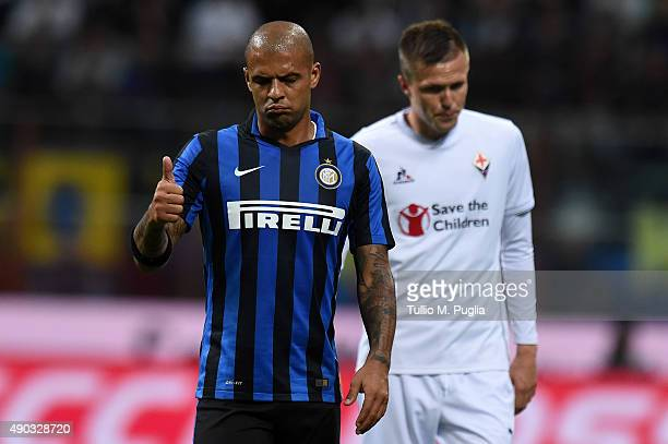 Felipe Melo of Internazionale Milano gestures as Josip Ilicic of Fiorentina looks on during the Serie A match between FC Internazionale Milano and...