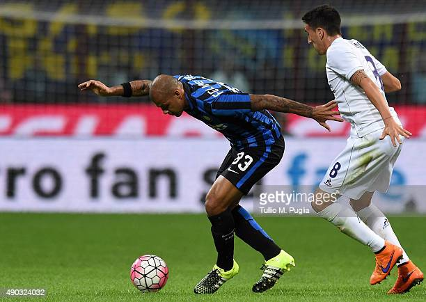 Felipe Melo of Internazionale Milano is challenged by Matias Vecino of Fiorentina during the Serie A match between FC Internazionale Milano and ACF...