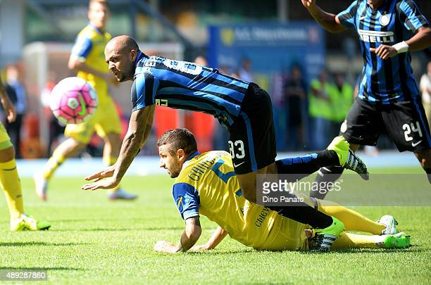 Felipe Melo of Internazionale Milano is tackled to Alessandro Gamberini of Chievo Veona during the Serie A match between AC Chievo Verona and FC...