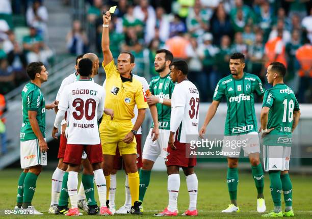 Felipe Melo of Palmeiras receives the yellow card during the match between Palmeiras and Fluminense for the Brasileirao Series A 2017 at Allianz...