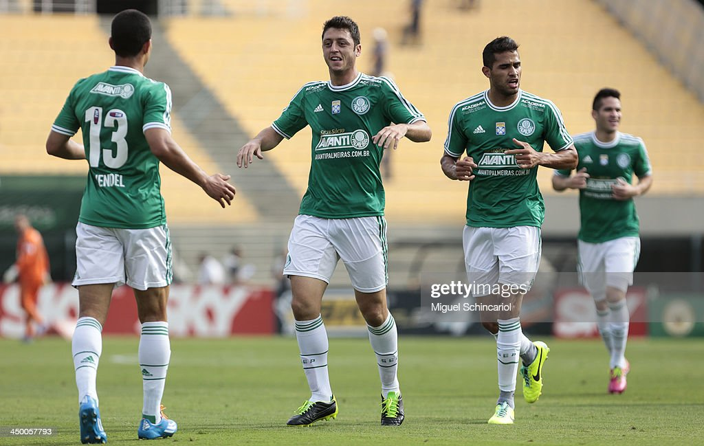 Felipe Menezes (L) of Palmeiras celebrate a goal during the match between Palmeiras and Boa Esporte for the Brazilian Championship Series B 2013 at Pacaembu Stadium on November 16, 2013 in Sao Paulo, Brazil.