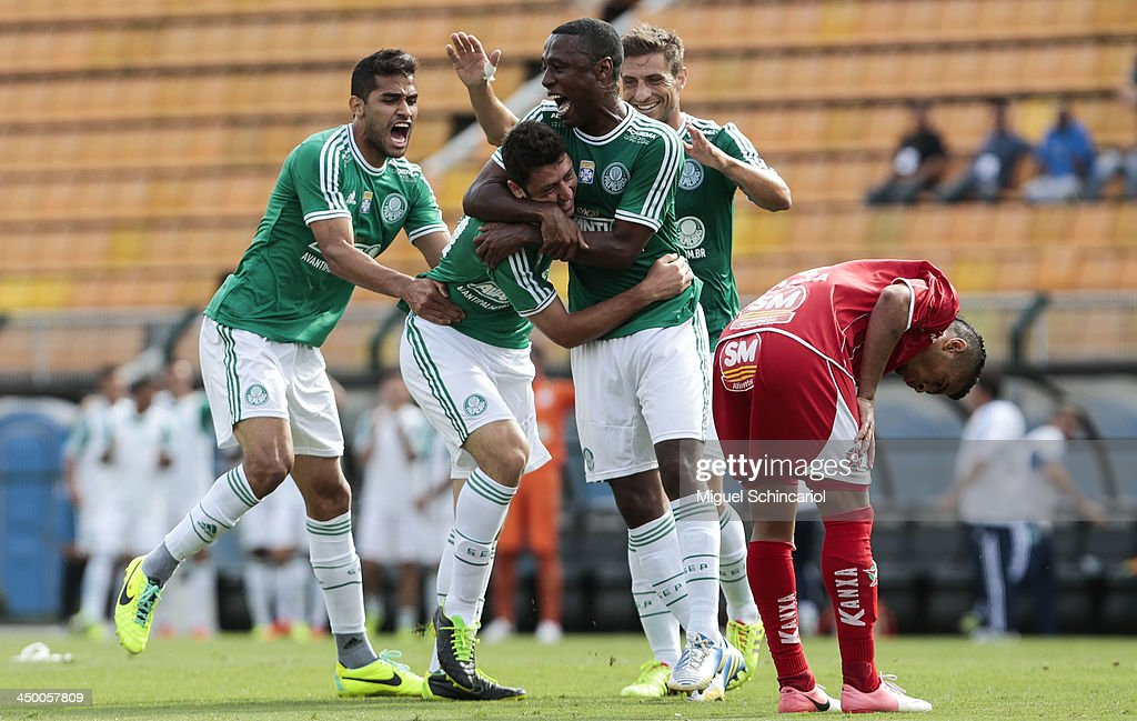 Felipe Menezes (C) of Palmeiras celebrate a goal during the match between Palmeiras and Boa Esporte for the Brazilian Championship Series B 2013 at Pacaembu Stadium on November 16, 2013 in Sao Paulo, Brazil.
