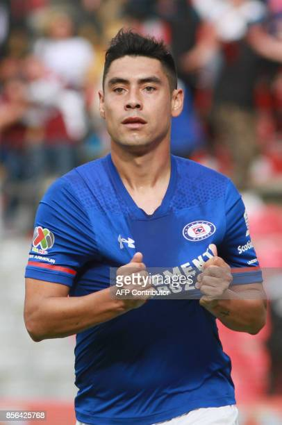 Felipe Mora of Cruz Azul celebrates his goal against Pumas during their Mexican Apertura tournament football match at La Corregidora stadium on...