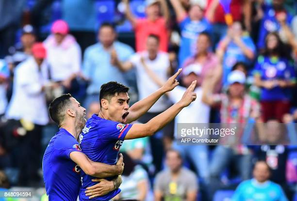 Felipe Mora of Cruz Azul celebrates his goal against Santos during their 2017 Mexican Apertura football tournament match at the Azul stadium in...