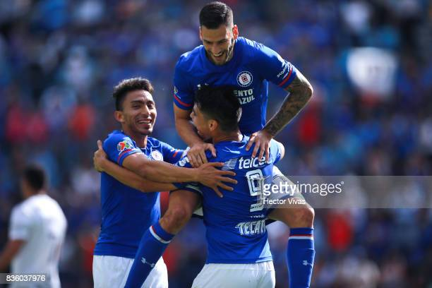 Felipe Mora of Cruz Azul celebrates with teammates after scoring the second goal of his team during the fifth round match between Cruz Azul and Atlas...
