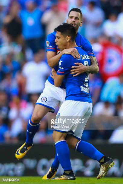 Felipe Mora of Cruz Azul celebrates with teammates after scoring the first goal of his team during the 9th round match between Cruz Azul and Santos...