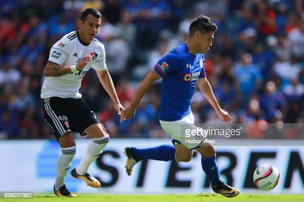 Felipe Mora of Cruz Azul shots on target and scores the second goal of his team against Daniel Arreola of Atlas during the fifth round match between...
