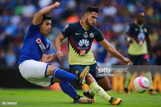 Felipe Mora of Cruz Azul struggles for the ball with Bruno Valdez of America during the 13th round match between Cruz Azul and America as part of the...