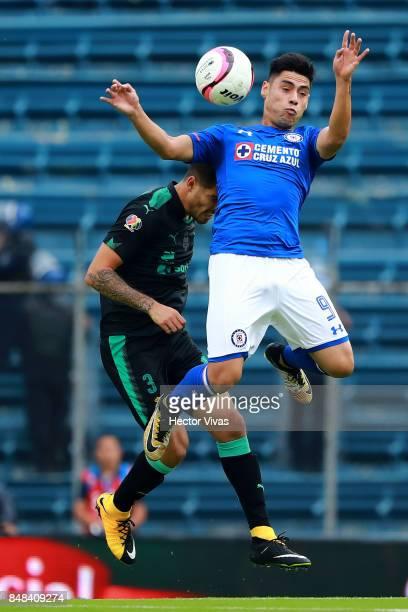 Felipe Mora of Cruz Azul struggles for the ball with Ventura Alvarado of Santos Laguna during the 9th round match between Cruz Azul and Santos Laguna...