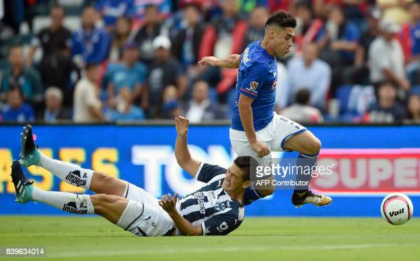 Felipe Mora of Cruz Azul vies for the ball with Edgar Castillo of Monterrey during their Mexican Apertura tournament football match at the Azul...