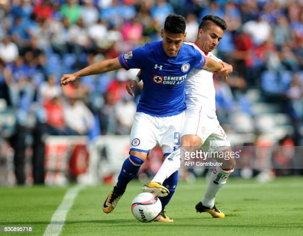 Felipe Mora of Cruz Azul vies for the ball with Rodrigo Gomez of Toluca during their Mexican Torneo Apertura 2017 football match at Azul Stadium in...