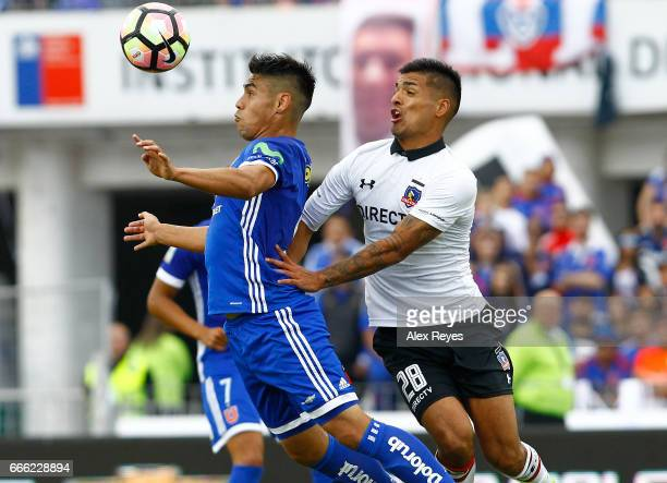 Felipe Mora of U De Chile goes for a header with Felipe Campos of Colo Colo during a match between U de Chile and Colo Colo as part of Torneo...