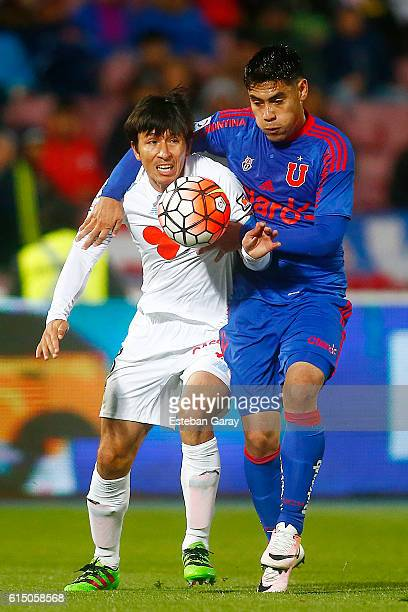 Felipe Mora of Universidad de Chile fights for the ball with Albert Acevedo of Ohiggins during a match between Universidad de Chile and Ohiggins as...