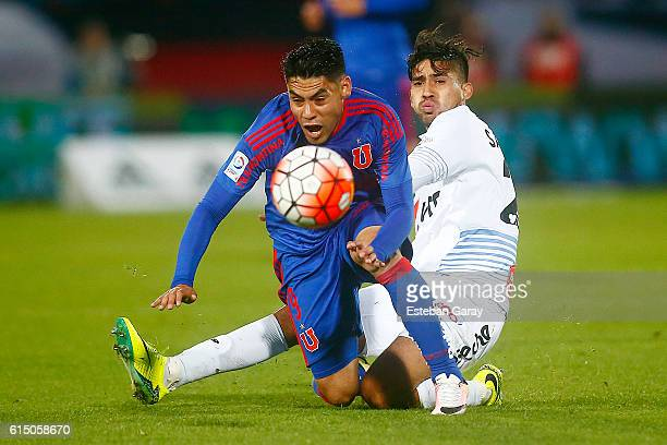 Felipe Mora of Universidad de Chile fights for the ball with Bastian San Juan of Ohiggins during a match between Universidad de Chile and Ohiggins as...