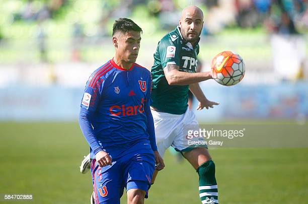 Felipe Mora of Universidad de Chile fights for the ball with Federico Perez of Santiago Wanderers during a match between Santiago Wanderers and...