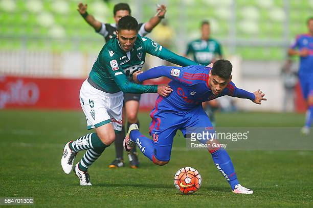 Felipe Mora of Universidad de Chile fights for the ball with Mario Parra of Santiago Wanderers during a match between Santiago Wanderers and...