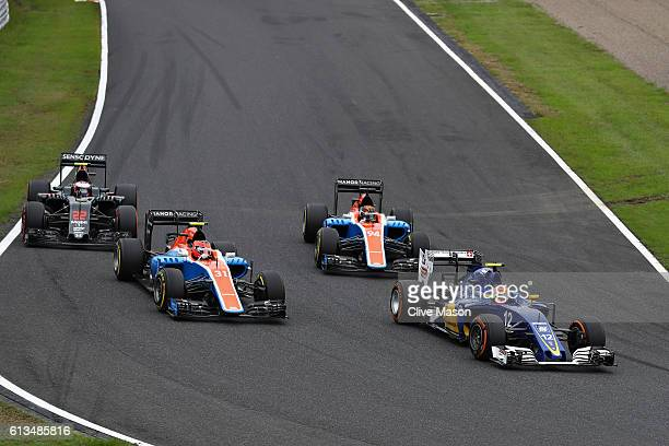 Felipe Nasr of Brazil driving the Sauber F1 Team Sauber C35 Ferrari 059/5 turbo leads Esteban Ocon of France driving the Manor Racing MRTMercedes...