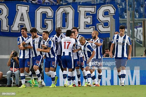 Felipe of FC Porto celebrates after scoring a goal during the UEFA Champions League playoff match between AS Roma and FC Porto at Stadio Olimpico on...