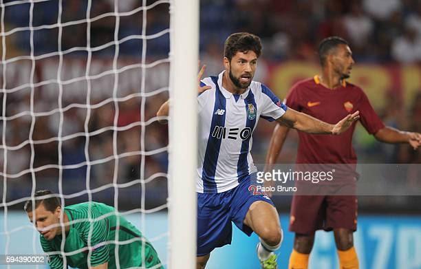 Felipe of FC Porto celebrates after scoring the opening goal during the UEFA Champions League qualifying playoff round second leg match between AS...